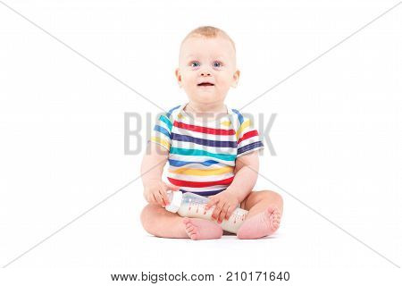 Cute Joyful Baby Boy In Colorful Shirt Hold Milk Bottle