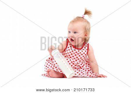 Cute Pretty Little Girl In Red Dress With Milk Bottle