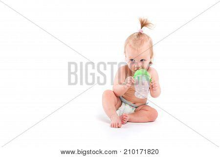 Cute Pretty Baby Girl In White Diaper Hold Bottle