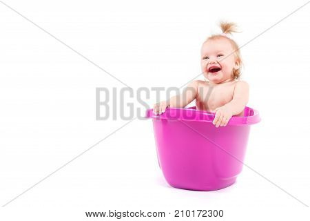 isolated on white cute happy caucasian baby girl take bath in purple tub hide in tub happy lauph