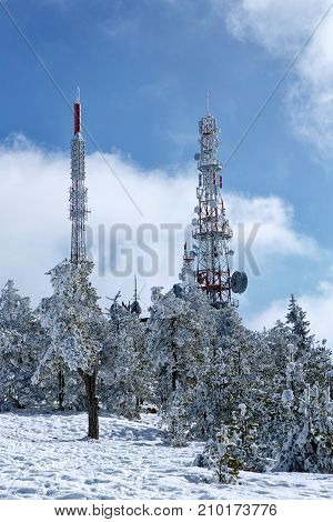 telecommunications towers covered with beautiful snow background