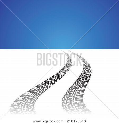 auto tire prints on white winter background