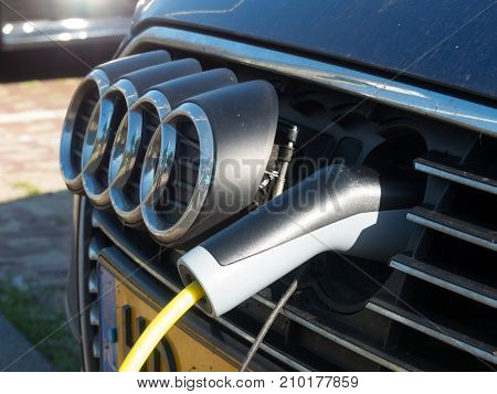 The Hague the Netherlands - 14 October 2017: charging an electric vehicle battery