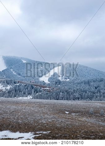 snowy mountains with downhill ski slopes background