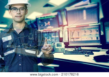 Double exposure of Engineer or Technician man in working shirt press his finger for new innovation with group of computers room background business and industry concept.