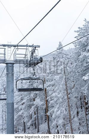 snow mountains with modern ski lift chair in winter