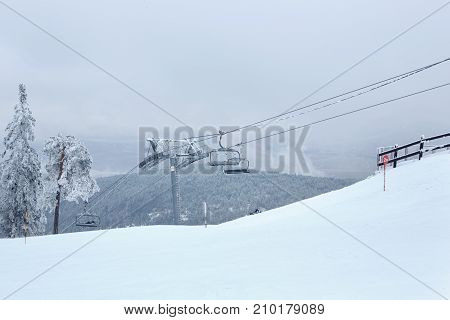 winter mountain landscape with modern ski lift-extreme sports