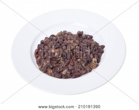 Roasted beans with sauce and herbs.  Isolated on a white background.