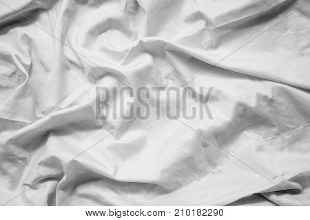 White fabric abstract background concept. white wrinkled silk cloth wave texture satin material