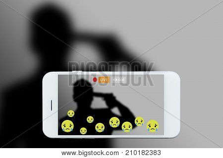 Problem of using social networks with wrong purpose effect concept:silhouette of man holding gun in hand stream his commits suicide stream live on social media. Crime violence within social networks.