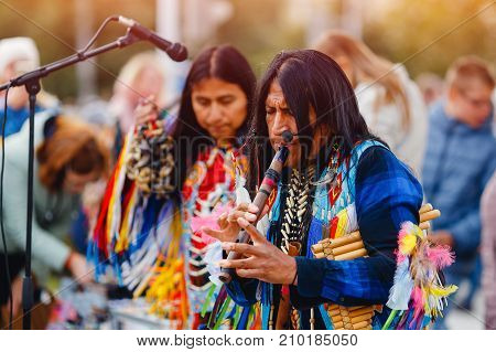 EDISON, NJ - June 26, 2017: folk performance indians america songs, microphones, pipe, trumpet KENA