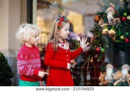 Kids Shopping For Christmas Presents. Children Buy Xmas Decoration