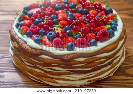 Close up tasty layer cake with berries