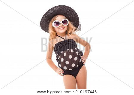 Attractive Little Girl In In Black Swimwear, White Sunglasses And Black Hat