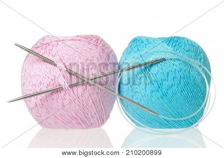 Colorful threads with knitting accessories isolated on white background