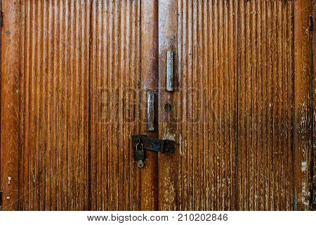 Old wooden cabinet with lock and key