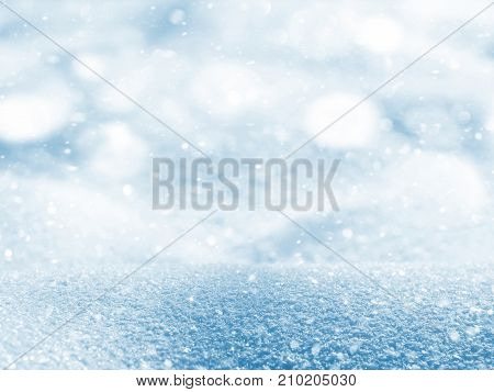 Winter bright background with snowdrifts and falling snow.