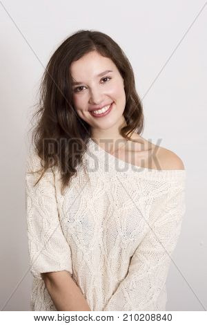 a young woman posing wearing a jumper