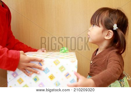 Japanese Girl And A Birthday Present (3 Years Old)