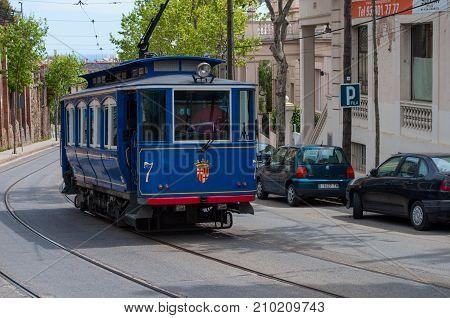 Blue Tram In Barcelona Spain