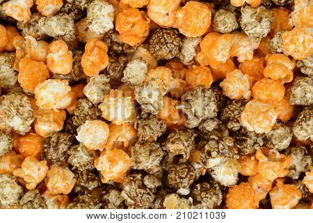 closeup of halloween black licorice and orange popcorn