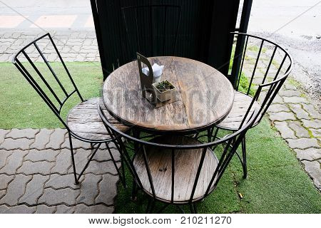 wooden Table and wooden chairs in a coffee shop