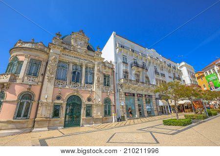 Coimbra, Portugal - August 14, 2017: Bank of Portugal Building or Edificio do Banco de Portugal in Largo de Portagem square. Historic medieval district in lower Coimbra, Central Portugal, Europe.