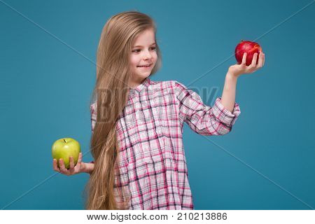 Little Beauty Girl In Shirt With Long Brown Hair With Apple In Hands