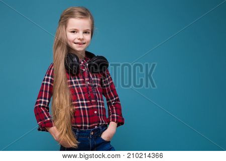 Cute Girl In Shirt And Earphones With Long Hair
