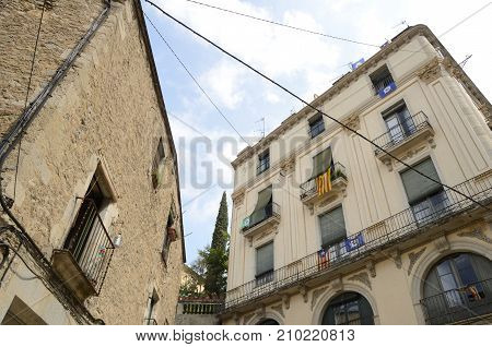 GIRONA, SPAIN - JULY 24, 2017: Independents flags on building of the old town in Girona Spain.