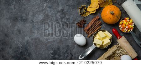 Thanksgiving concept - baking ingredients and symbols, rustic background, top view