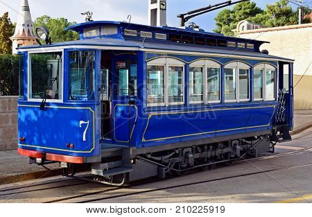 Blue ancient Train streetcar in use Barcelona