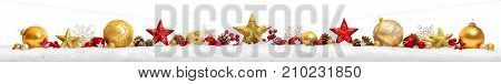 Christmas border or banner with stars and baubles arranged in a row on snow extra wide and isolated on white background