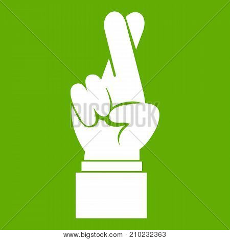 Fingers crossed icon white isolated on green background. Vector illustration