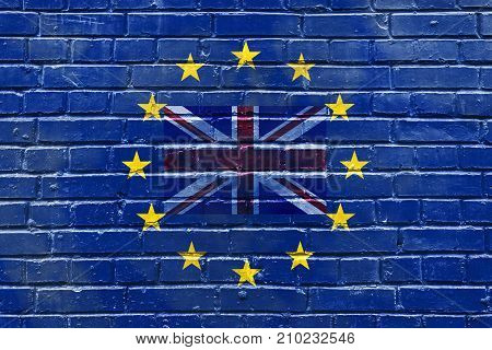 a brick wall with a flag of the Great Britain inside the flag of the European Union