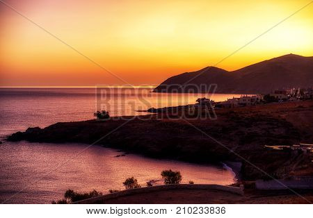 Sunrise. Colorful sky and silhouette at village panormos Crete island - Greece