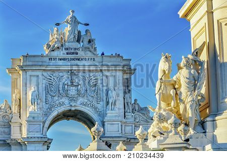 Rua Augusta Arch Baixa Praca de Comercio Palace Square Lisbon Portugal. Arch created 1755 to commemorate city's reconstruction from 1755 earthquake. Rua Augusta is main walking street in Lisbon. Statues of King Jose 1 of Portugal.
