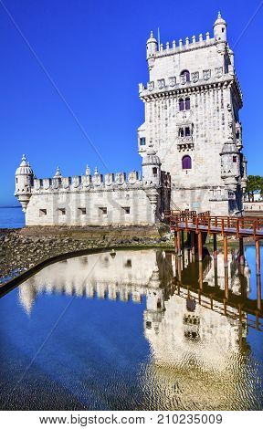 Belem Tower Torre de Belem Portuguese Symbol of Exploration Reflection Lisbon Portugal. Belem Tower was constructed in early 1500s on Tagus River and last point Portguese explorers saw when left Lisbon.