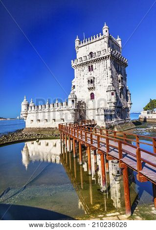 Belem Tower Torre de Belem Portuguese Symbol of Exploration Rflection Lisbon Portugal. Belem Tower was constructed in early 1500s on Tagus River and last point Portguese explorers saw when left Lisbon.