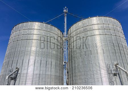 Indianapolis - Circa October 2017: Pair of Brock Stiffened Grain Bins. Brock is a Division of CTB a Berkshire Hathaway Company I