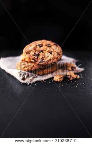 Chocolate chip cookies on dark table with copy place for text