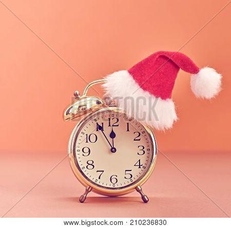 New Year Christmas holiday Gold Alarm Clock, Santa hat. XMAS background decoration Handmade. Happy New Year Design Ornament. Festive Art christmas Colorful Greeting Card. Vintage