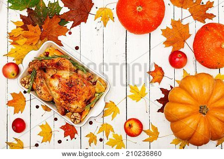 Roasted Turkey Garnished With Cranberries On A Rustic Style Table Decorated With Pumpkins, Orange, A