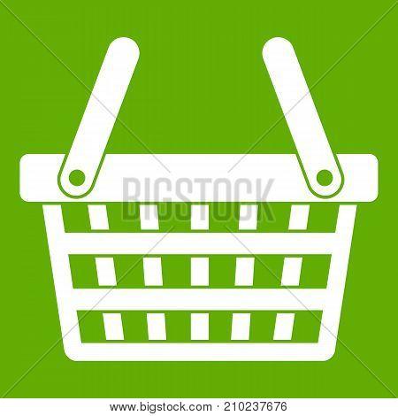 Shopping basket icon white isolated on green background. Vector illustration