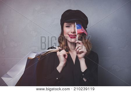 Girl With Shopping Bags And Flag Of Usa