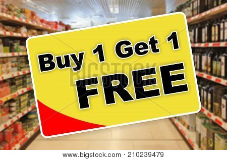 Buy One Get One Free Yellow Label On An Abstract Supermarket Background