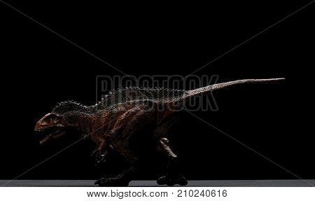 side view acrocanthosaurus toy on a black background