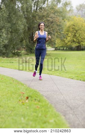 a young woman running in the park