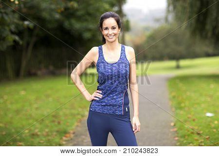 a skinny girl dressed in fitness wear