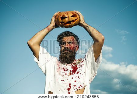 Halloween Zombie In Bloody Torn Tshirt With Jack O Lantern